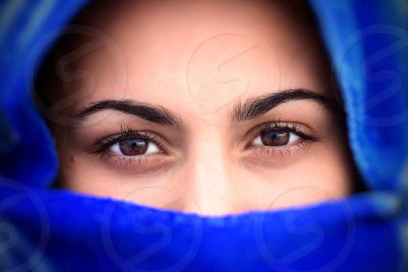 woman in blue hijab partly covering face photo
