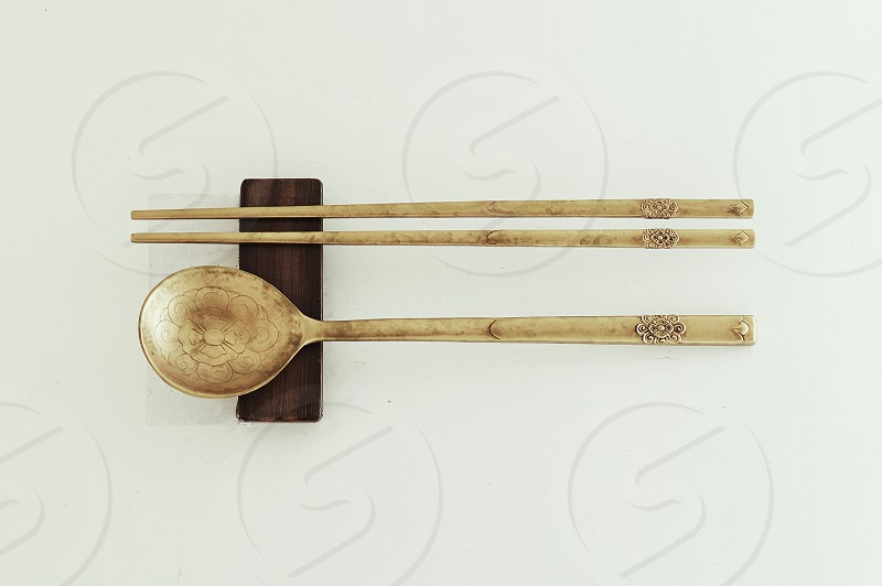 brown wooden ladle and chop stick on brown wooden panel photo