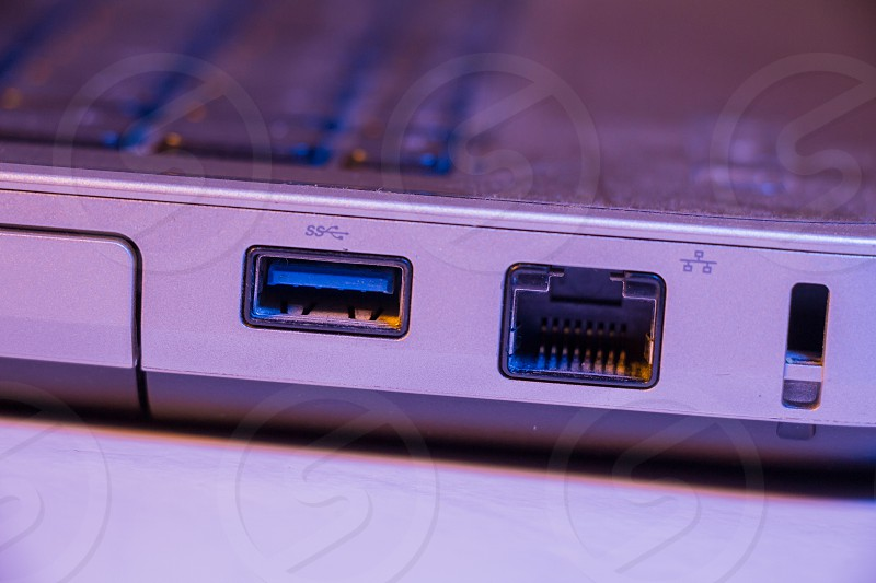 Closeup of Ethernet cable and USB ports in a laptop. photo