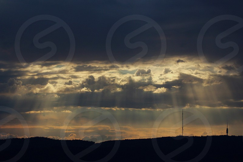sun rays covered with clouds photo