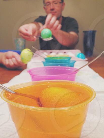 yellow liquid and ball in clear plastic drinking cup photo