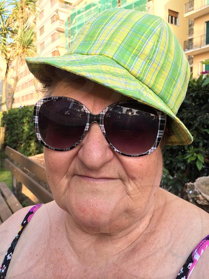 Old woman portrait with sunglasses photo