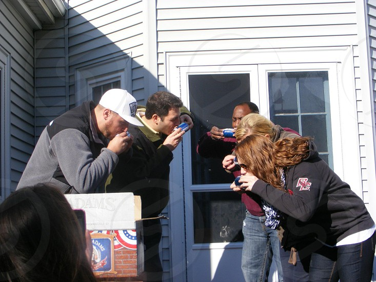 people drinking on a blue can photo