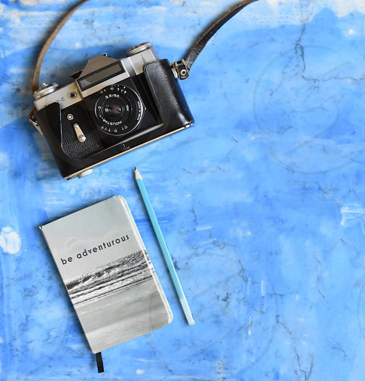 Overhead shot of a vintage camera and notebook photo