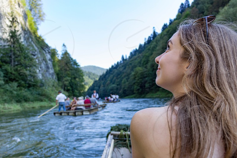 A girl enjoying her travel on the river Dunajec Pieniny Mountains Poland. photo