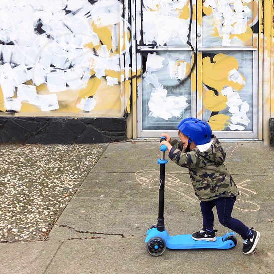 Child on scooter  photo
