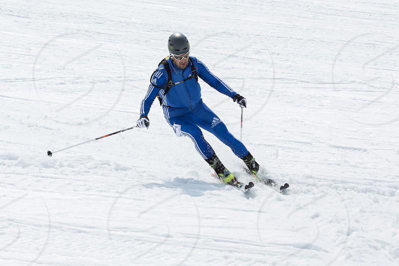 AVACHA KORYAK VOLCANOES KAMCHATKA RUSSIA - APRIL 27 2014: Ski mountaineer Alexander Sviridov skiing the mountain. Team Race ski mountaineering Asian ISMF Russian Kamchatka Championship. photo