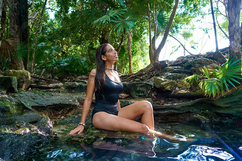 Latin girl bath in Cenote sinkhole at Riviera Maya of Mayan Mexico photo