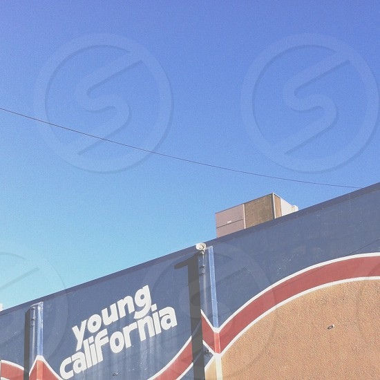 low-angle photo of Young California signboard photo