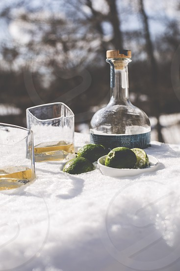 tequila drinks bottle limes in snow photo