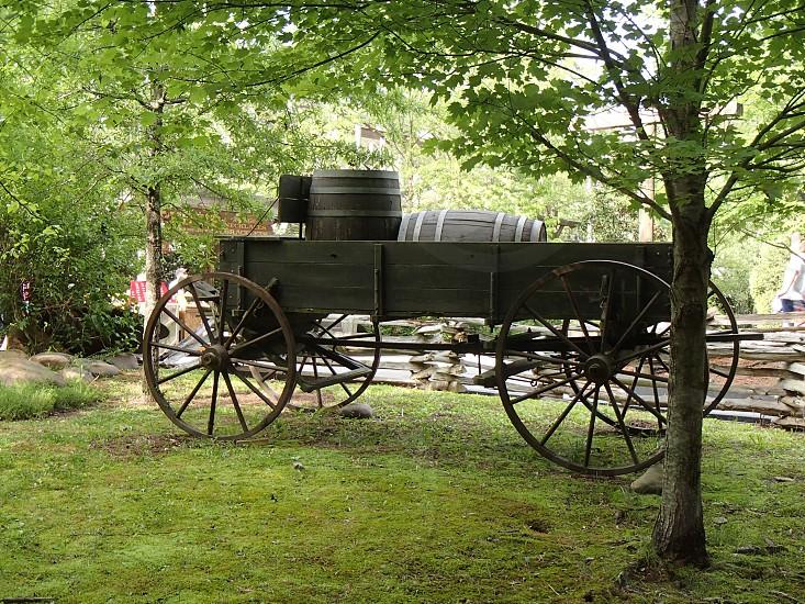 black wooden barrel in black wooden cart photo