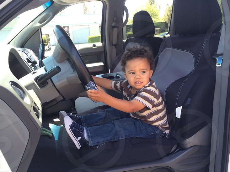 Baby driving daddy's car photo