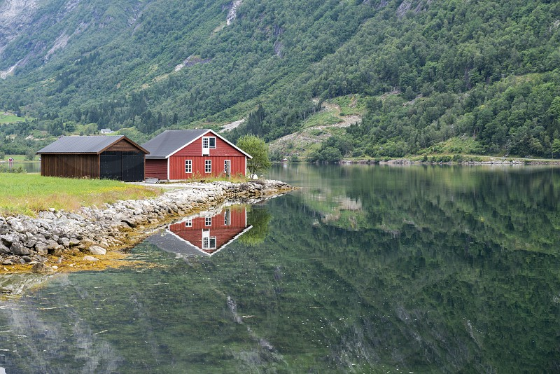 typical norway fjord with red wooden houses and reflection in the water photo