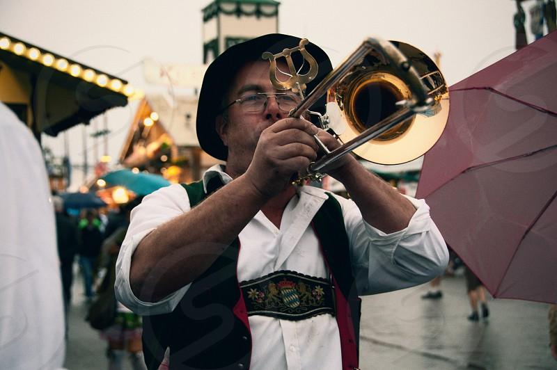 A musician plays the trombone at Oktoberfest in Munich. photo