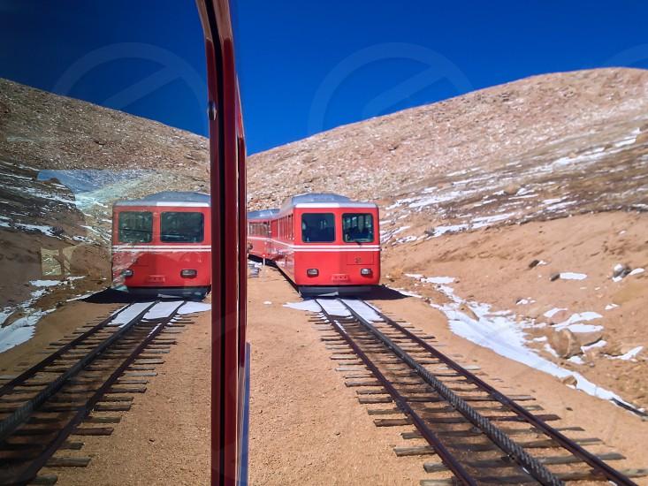 2 trains on railroad photo