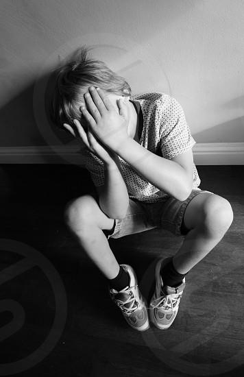 Sad depressed shy child kid boy alone abuse photo