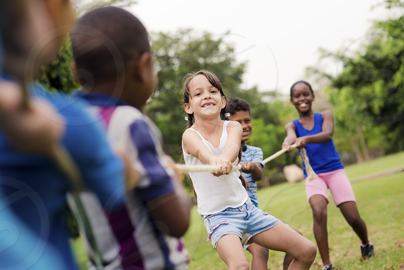 summer; camp; rope; group; pulling; game; girl; activity; black; boys; caucasian; cheerful; child; children; competition; effort; elementary age; energy; enjoy; female; free time; friends; friendship; fun; girls; happiness; happy; hispanic; holidays; joy; kids; latina; laughing; leisure; male; outdoor; park; people; persons; playing; recreation; smiling; strength; students; summer camp; tug of war; tug-of-war; vacation; whistle; young photo