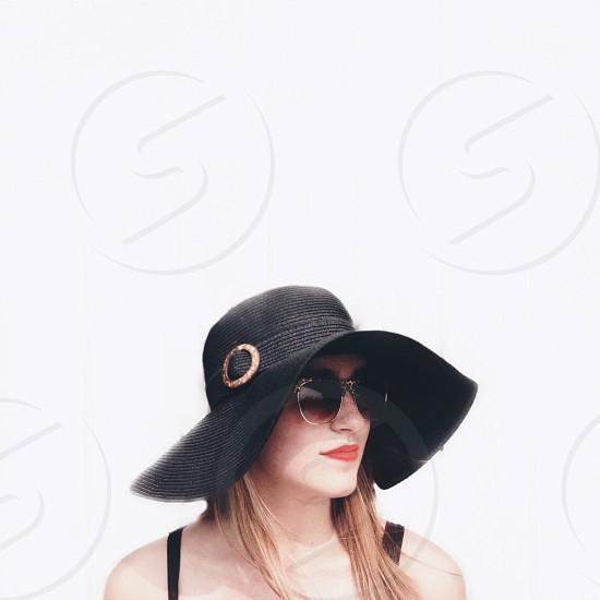 woman wearing black sunday hat photo