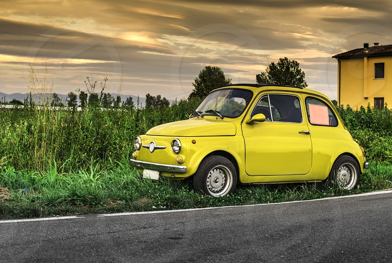 Small vintage italian car Fiat Abarth. Yellow color photo