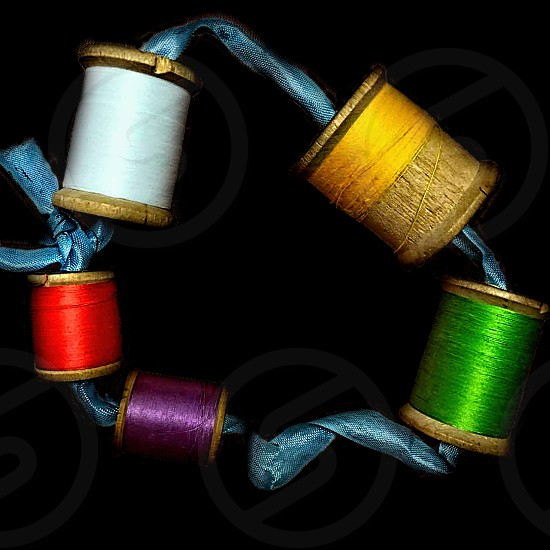 A string of colorful vibrant sewing thread photo