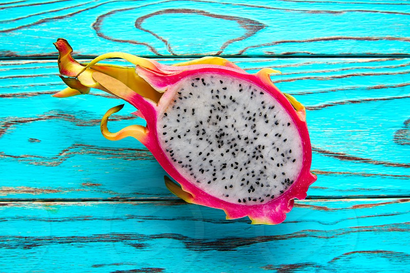 Pitaya dragon fruit cutted in pink and green background photo