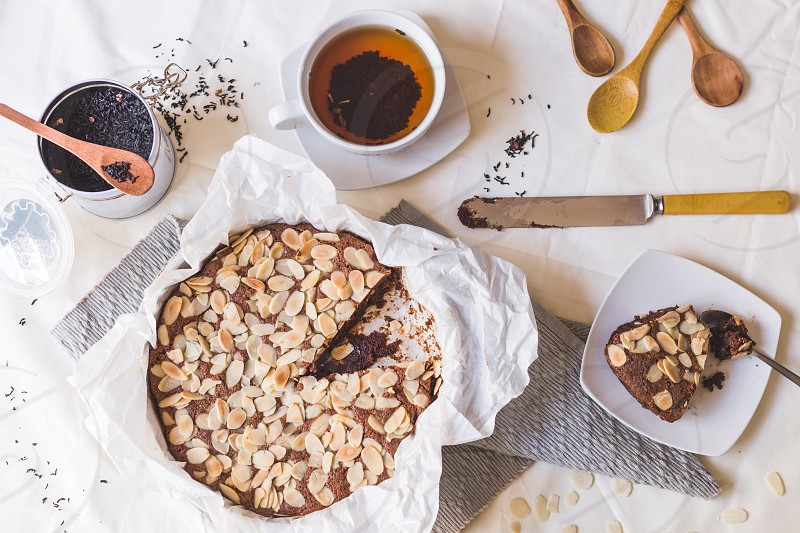 Almond kuchen tea and wooden spoons photo