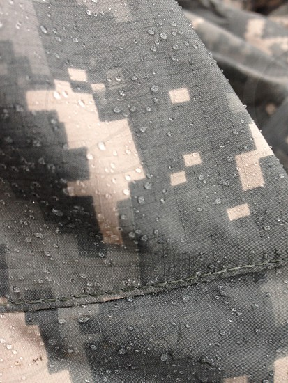grey and white camouflage textile photo