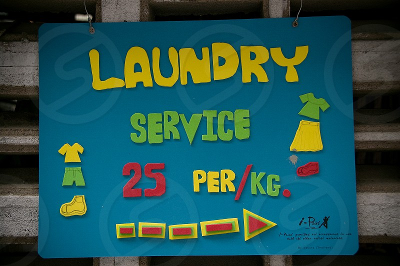 A sign advertising a laundry service in Chiang Mai Thailand. photo