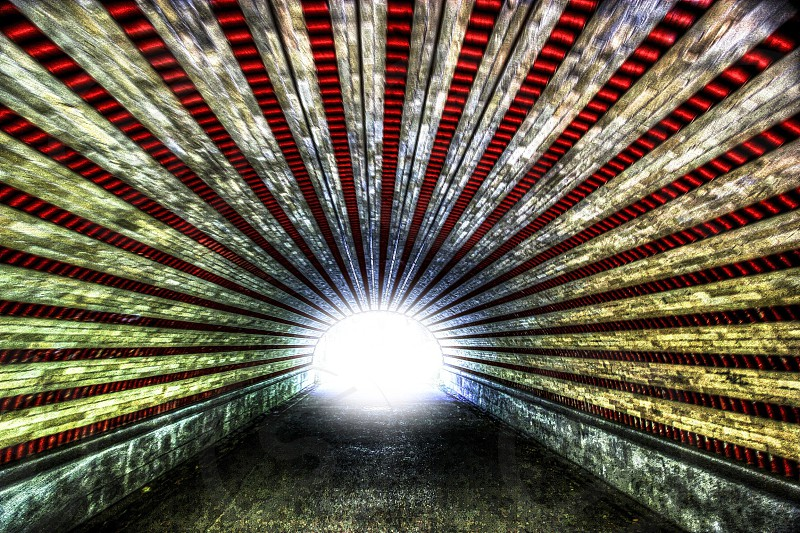 photo of yellow red and black tunnel photo