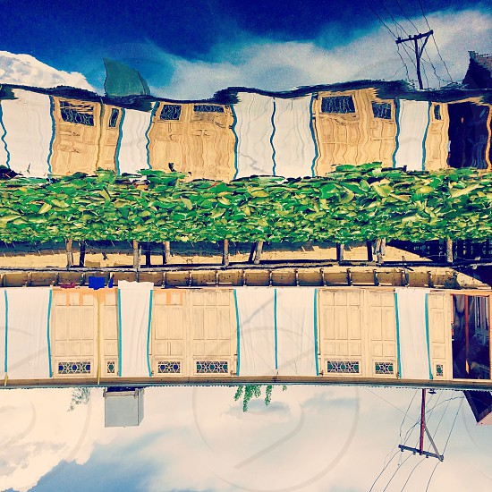 Reflection of the houseboat on the ever serene Dal Lake in Srinagar Kashmir India photo