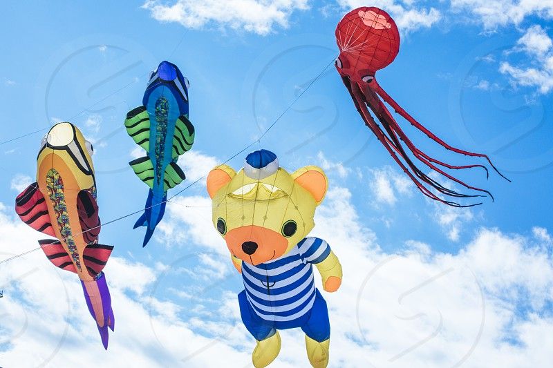 Flying kite with the shape of sea and Fantastic characters. photo