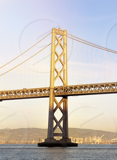 Tower of the Oakland Bay Bridge suspension bridge that connects the city of San Francisco with the island of Yerba Buena and the Oakland area photo