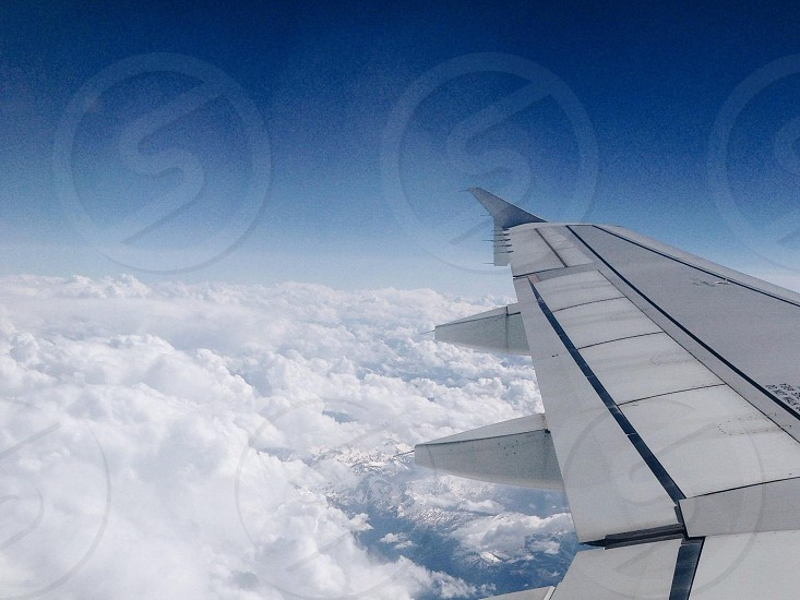Airplane. Sky. Clouds. Fly.  photo