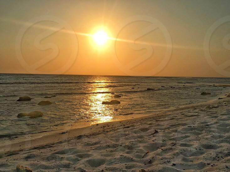 Sunset Aruba water ocean sea waves sun  photo
