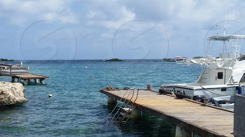 Aruba Water Ocean Dock Boat Waves Blue sky sunshine photo
