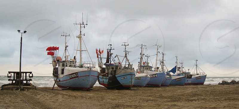 Fishing boats on shore at West Coast Denmark photo
