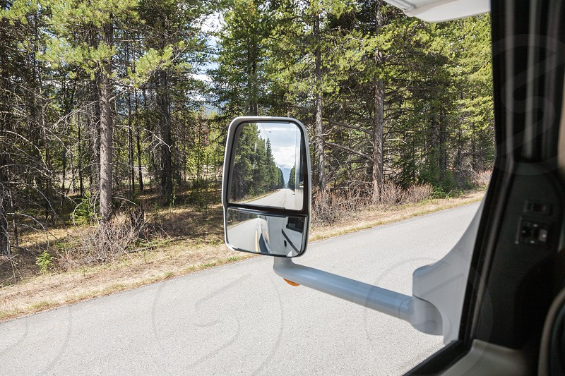 looking in the mirror during a trip with the RV in Canada photo