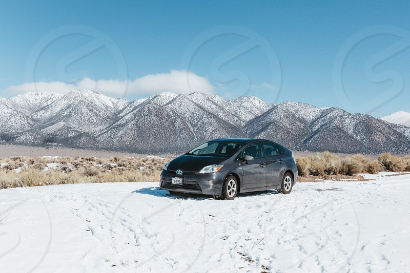 Car parked in a beautiful winter scene photo