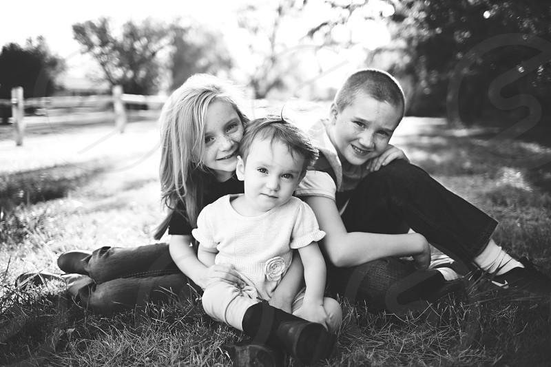 Siblings cuddling  photo