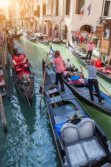 Several gondolas with gondoliers in Venice Italy. Beautiful view on Grand Canal. photo