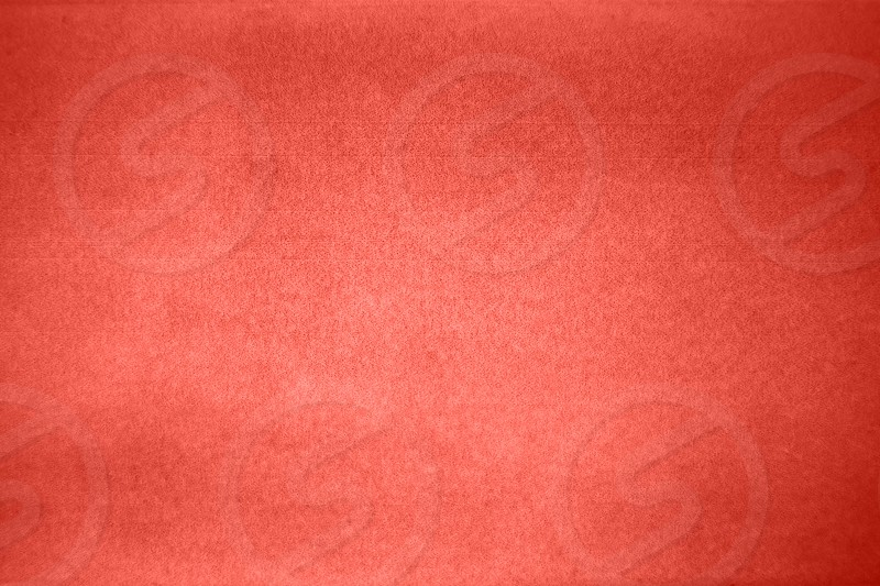 Creative concrete background surface in a trendy color of the year 2019 Living Coral pantone. Can be used for your ideas of design. photo
