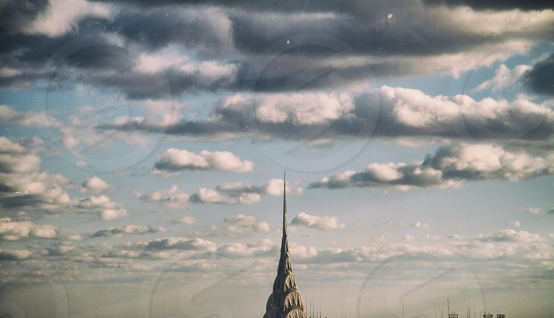 dark clouds and tall building photo