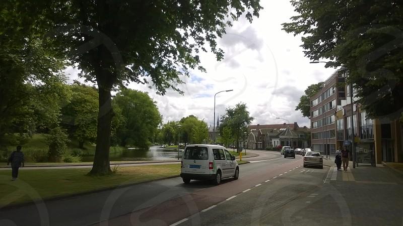 Holland Netherlands Alkmaar Park Street Cars Canal Trees River Pedestrians  photo
