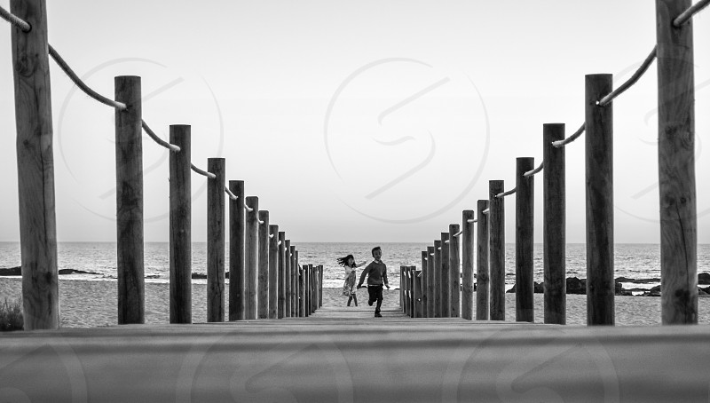 two child running in the dock photo