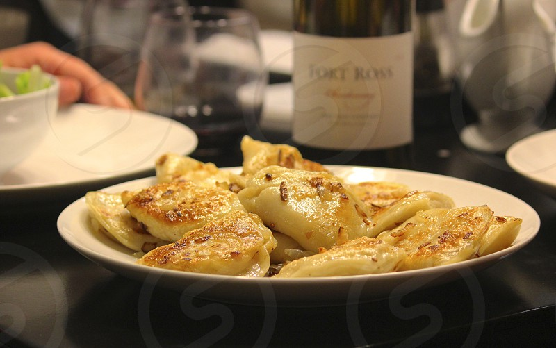 Pierogies and wine with friends photo
