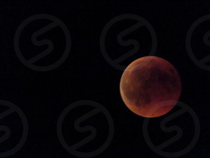 Full red moon in the night scrape photo