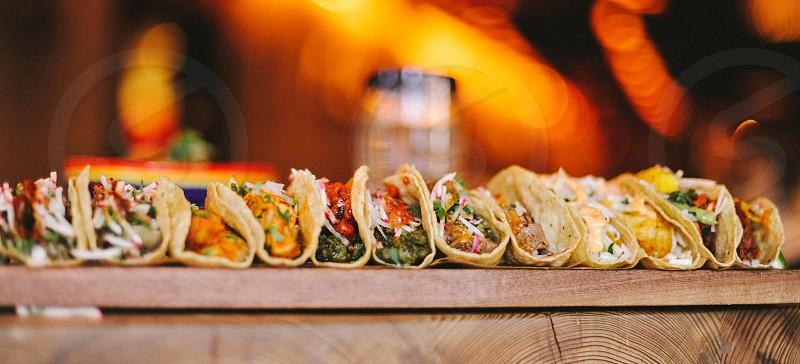 many tacos on a board photo