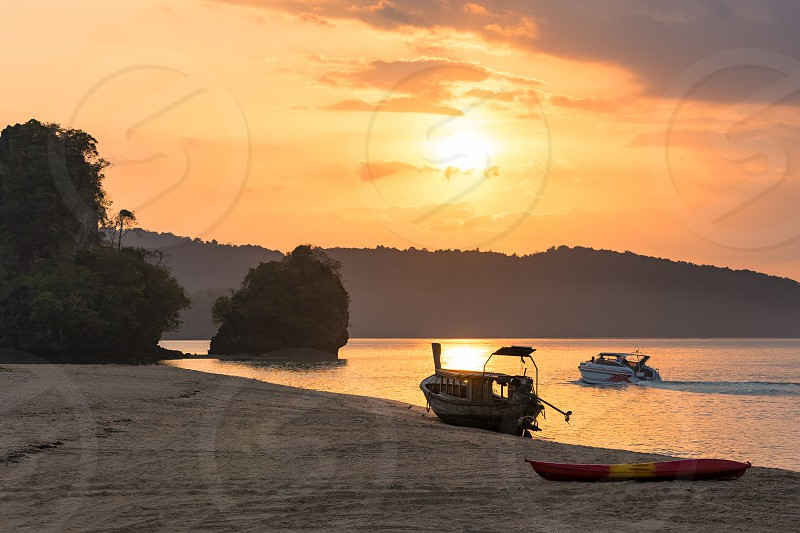 Nopparat Thara Krabi Province Thailand - January 14 2019: Three different type of water transport for leisure activity and traveling in Krabi province photo