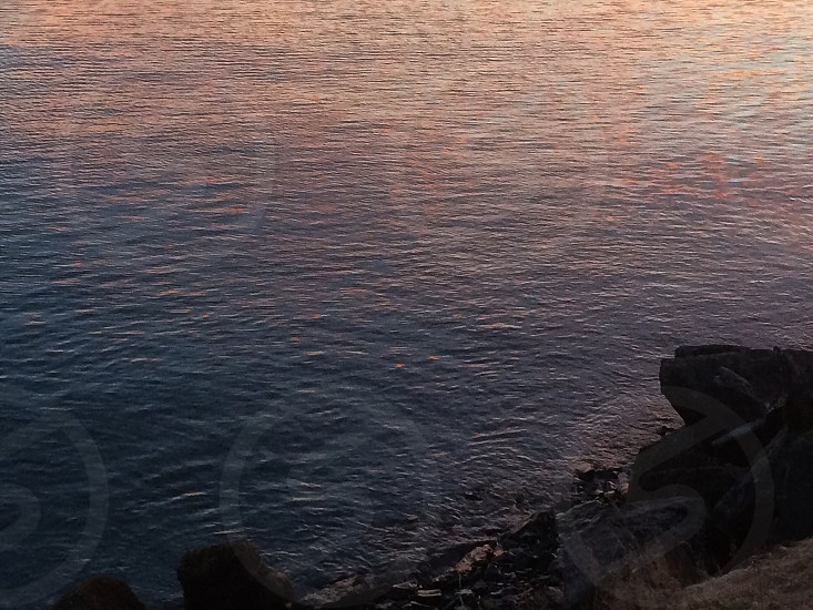 The channel between Kodiak and Near Island at sunset. (water sunset ocean reflection abstract blue pink nature) photo