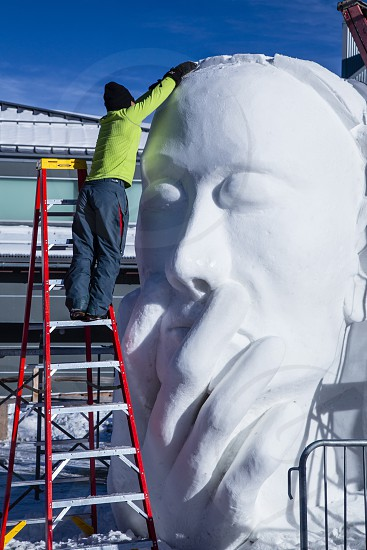 Ice sculptor working on project at Breckenridge Colorado  Ice Festival photo